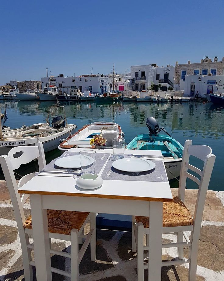 Paros island: Table at the picturesque port of the amazing Naousa. Have a nice day!