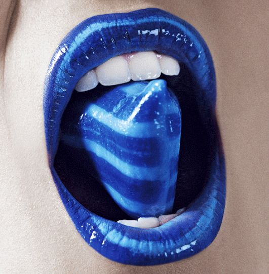 I think the candy is supposed to be the tongue but i'm not sure. i like the lips color.