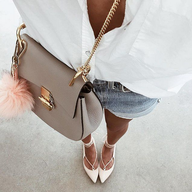 Julie Sariñana from Sincerely Jules accessories her Chloé Drew Saddle bag with a fluffy pom pom