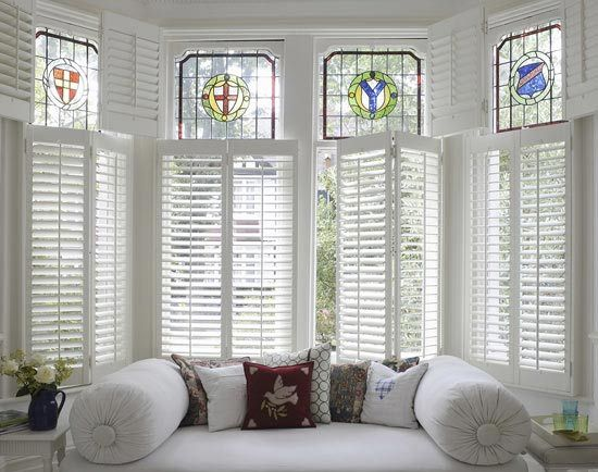 Shutters love the combination of shutters and stained for Should plantation shutters match trim