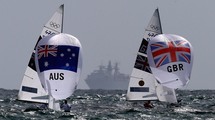 Elise Rechichi and Belinda Stowell of Australia and Hannah Mills and Saskia Clark of Great Britain get their spinnakers flying on the downwind leg in the women's 470 Sailing on Day 8. Australia were in seventh place after four races at Weymouth and Portland, while GB ranked in second place.