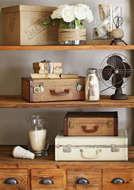 Recycled storage: Hard-sided suitcases store files on a shelving unit. More decorating ideas for vintage finds: http://www.midwestliving.com/homes/decorating-ideas/decorating-ideas-for-vintage-finds/page/28/0