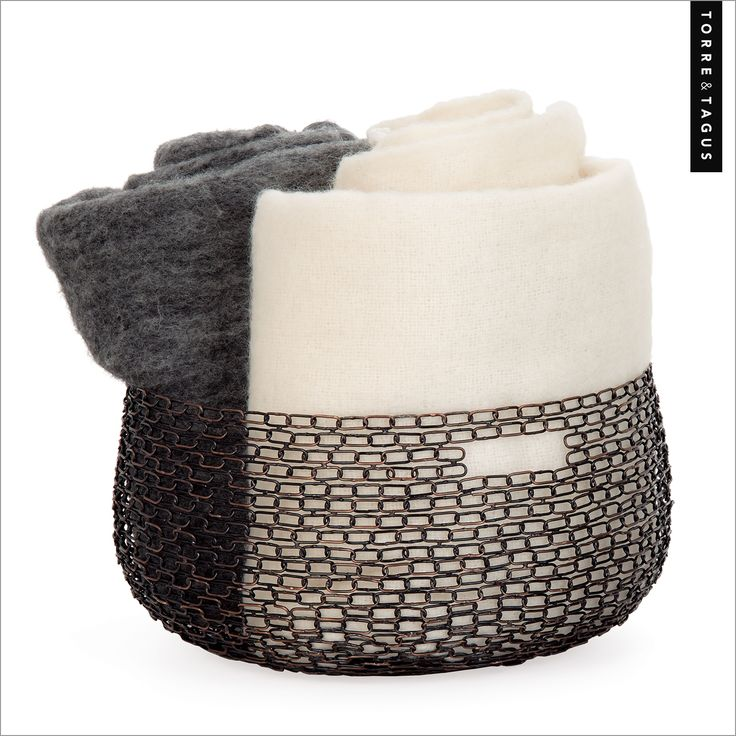 Throws and blankets never looked so good than in our Anique Dera Link Baskets! Place them in any area of your home that needs a simple yet decorative storage solution. #TorreAndTagus #OrganizeYourHome #Baskets www.torretagus.com