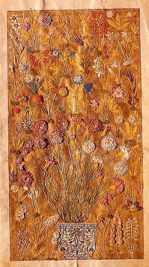 Exquisite cut-work paper compositions were made by Ottoman artists. this example shows a flower garden or meadow with carnations growing in a pot in the foreground. The flowers are so realistic and inticately made that they could almost be mistaken for dried flowers. Cut-paper work composition.
