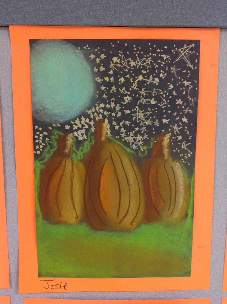 3rd grade.  Chalk pastel on black paper, with gold paint marker stars