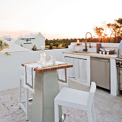 This rooftop kitchen provides everything needed for an evening cookout