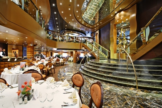 MSC SPLENDIDA - La Reggia Restaurant    Like the theatre La Reggia puts on a spectacular show night after night. The restaurant is distinguished by the attention paid to the details of its furnishings, refined porcelain to crystal glasses and silver flatware. And, every evening, La Reggia offers a different menu to celebrate an Italian region with its typical cuisine and most renowned wines.
