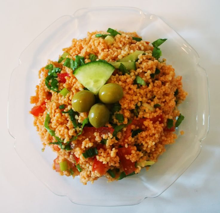 Kısır - A very popular meze or side dish prepared with fine-ground bulgur, tomato paste, parsley, onion, garlic, sour pomegranate juice and a lot of spices