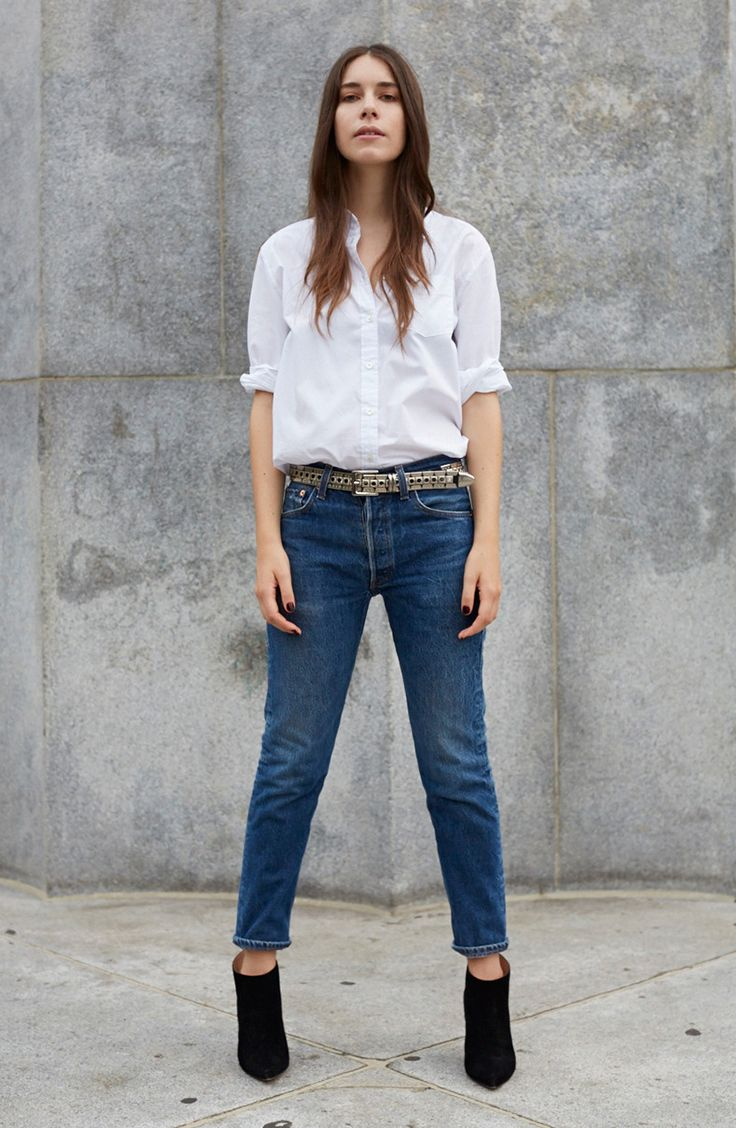 Meet Danielle, one of three sisters that make up the indie rock band HAIM. Danielle pairs her 501 CT Jeans with a statement belt, black booties and a simple button down. #LiveInLevis.