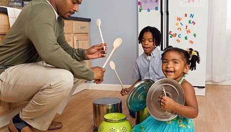 Kids making music with pots and pans