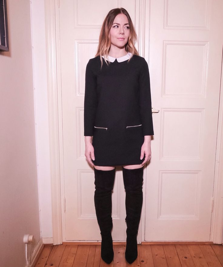 Black dress with over the knee boots.