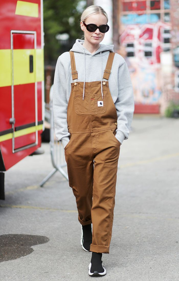See 10 street style–approved ways to wear overalls in the fall and winter, and shop the best pairs to layer with this season.
