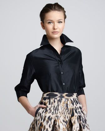 The trick is on the neck... ;)   Classic Silk Taffeta Blouse, Black by Carolina Herrera at Neiman Marcus.