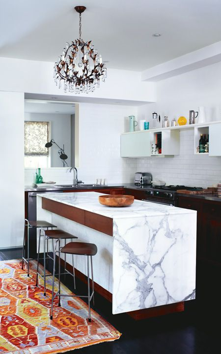 Suzanne Dimma's Kitchen, the rug really warms up the space.  Love the waterfall island.