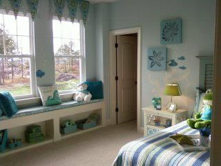 Cute mermaid room with under the sea elements loosely painted around the room.