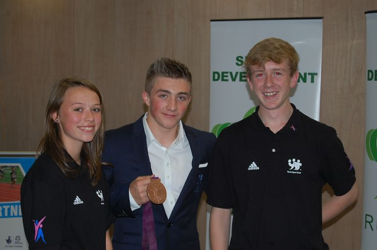 Good luck to Sam Oldham who is pictured at our sports awards with his Olympic Bronze medal and two of our young volunteers.