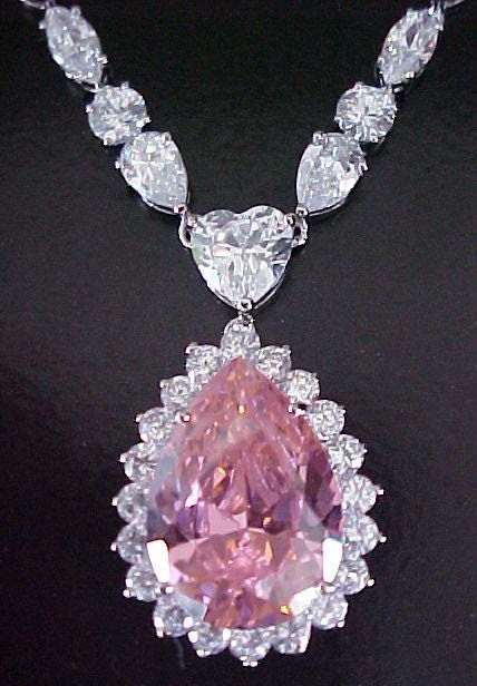 pink diamond necklace - It matches my pink cheeks! lol I bet these come in fake glass versions for under a hundred bucks. :0)