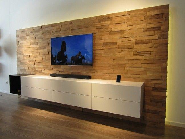 Mutatós díszítés egy minimal stílusú médiaszekrényhez és egy lapos képernyős tévéhez! A tölgyfa anyag garantálja a keményfa hasábokból összeállított panelek dekoratív megjelenését, amelyek az idő múlásával csak még szebbé válnak, ahogy érik a fa.