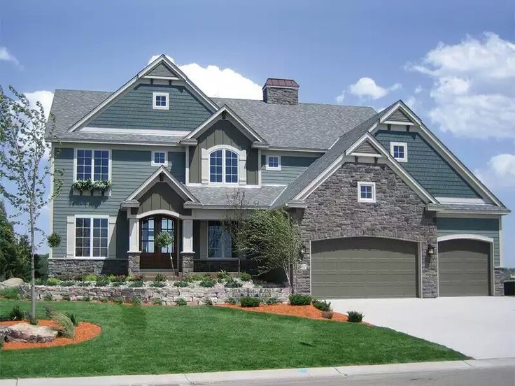 Love these blues and the stone home exteriors pinterest for Design traditions home plans