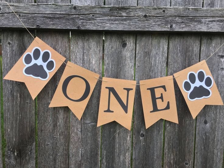 Paw print Birthday banner. Pawty banner. Puppies first birthday. Dog birthday party. Cake smash photo prop. by TinCakes on Etsy https://www.etsy.com/listing/553106089/paw-print-birthday-banner-pawty-banner #DogParty