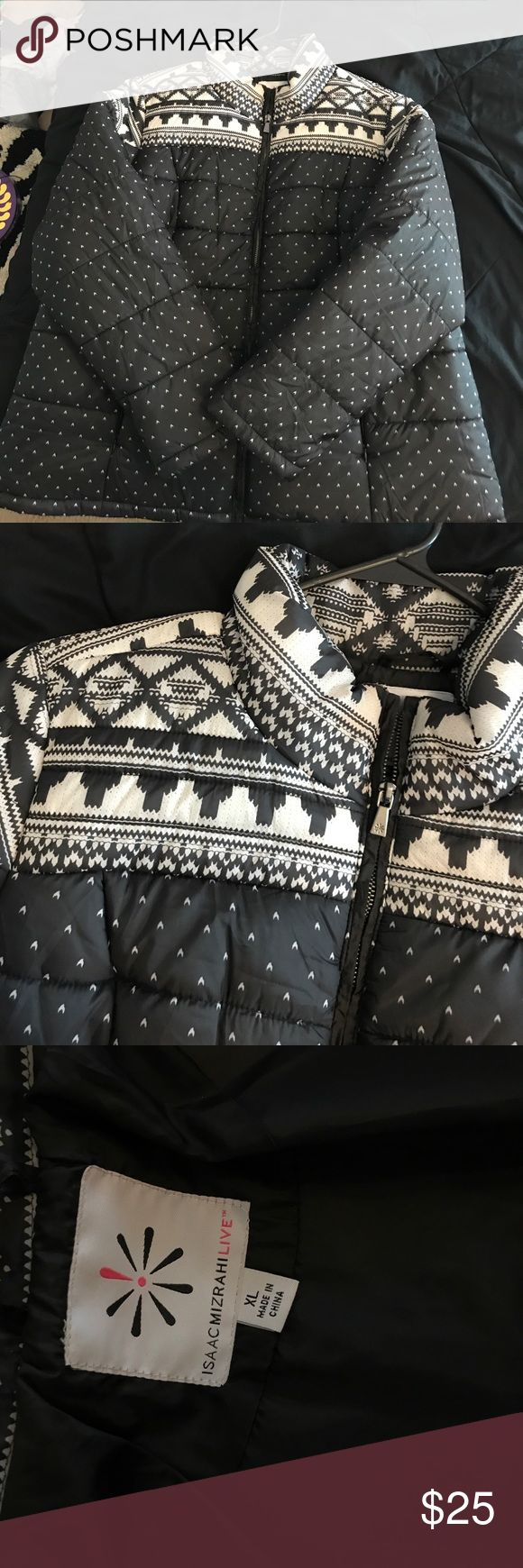 Black and White Snow Coat Black and white snow coat - no hood. pockets have zippers and are furry. Never worn. Isaac Mizrahi Jackets & Coats Puffers