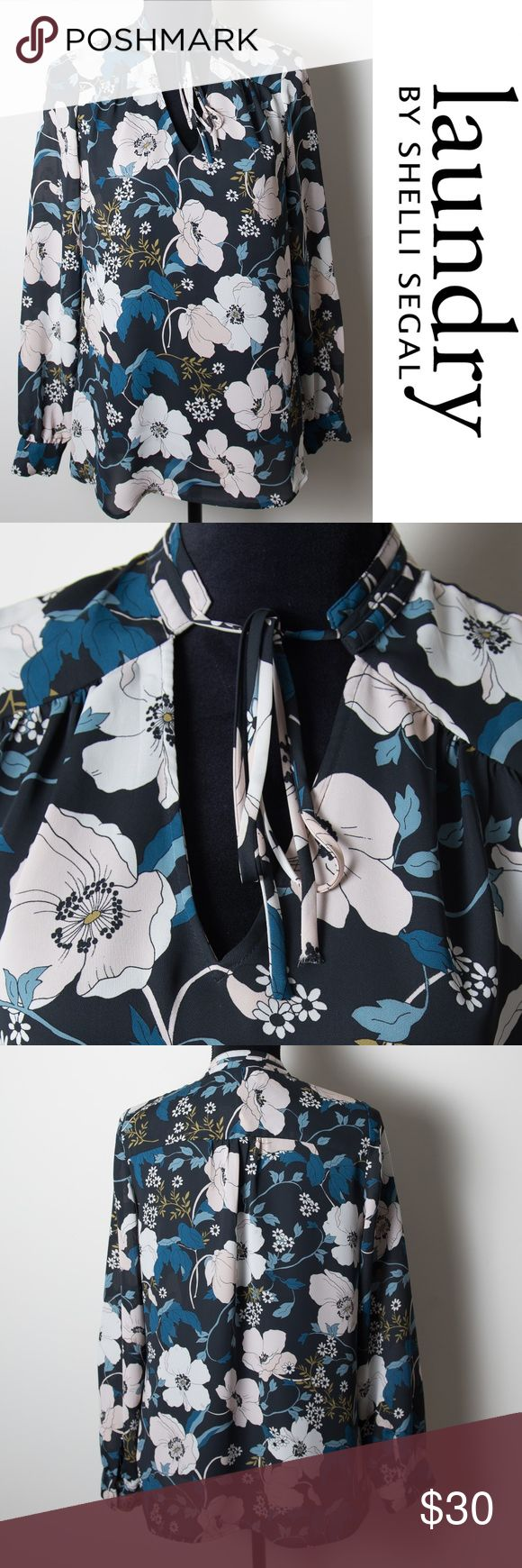 Laundry Shelli Segal Floral Front Tie Shirt Tunic Size 8 long sleeve blouse from Laundry Shelli Segal. Size 8. Flouncy tie trims the v-neck of this lightweight top covered in a floral pattern. Black with white, soft pink, shades of blue and green. Button cuffs. Good preloved condition. No noticeable holes, stains or rips. Laundry By Shelli Segal Tops Tunics