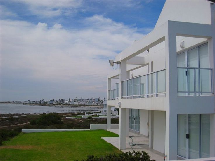 Joubert - This double-storey house is situated on the beachfront in Shelley Beach.  The house has four bedrooms and a balcony shared by three of these bedrooms.  Two of the bedrooms have double beds, one has two ... #weekendgetaways #shelleypoint #southafrica