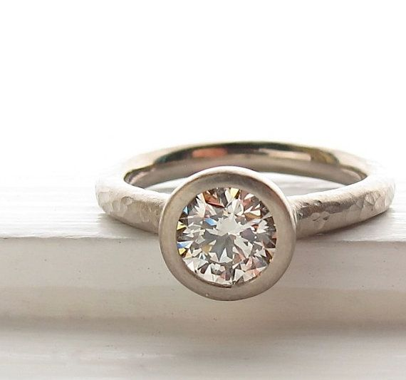 1ct diamond pebble solitaire. Water hammer texture. Palladium white gold.