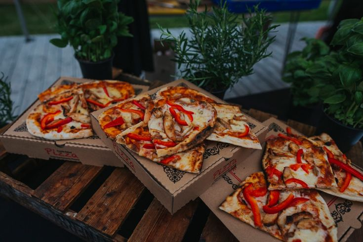 Some of the best wedding evening food I've ever had. Fresh pizza from a pizza oven - a must have! By Flying Pig Catering. Photo by Benjamin Stuart Photography #weddingphotography #pizza #eveningfood #weddingfood #pizzaoven #flyingpigcatering