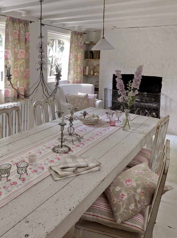 Pastel pinks and sage green against soft white make this dining room into a haven of tranquility and vintage style.