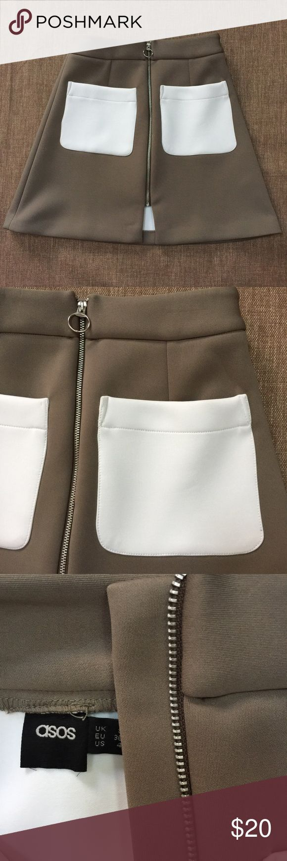 """Asos Skirt Size 4 Front zipper & white pockets This is an adorable  Asos Skirt in a size Size 4 it has a Front zipper & white pockets. Very well made. fabric is 98% polyester 2% elastane. An olive color with white pockets. 28"""" across waist laying flat. Top to bottom of skirt is 18"""".  This is is called an A-line skirt. Check our the photos for details. Back of the skirt is the solid color. ASOS Skirts"""