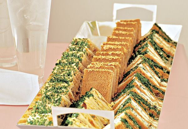 Memorable Brunch: Dainty Tea Sandwiches:   Tea Sandwiches, easy for standing guests to handle, usually evoke raised pinkies and lowered voices. But here they're spruced up with an edging of chopped herbs, which gives them an especially spring-like dash. To keep last-minute prep to a minimum, you can assemble the sandwiches a day ahead and store them in the fridge (trim the edges and dip the sandwiches in the herbs just before you're ready to eat). Photo: Christopher Baker; Styling: Philippa…