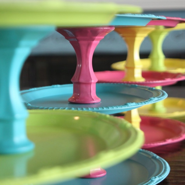 A carnival of color! DIY with Dollar Store finds. Serving plates or dinner plates and pillar candle holders. Paint the color of your choice, let dry for up to 4 hours, glue three plates to two candle holders together separating each plate.