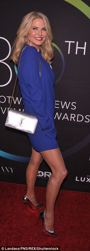 Christie Brinkley poses on the red carpet at the Footwear News Achievement Awards | Daily Mail Online