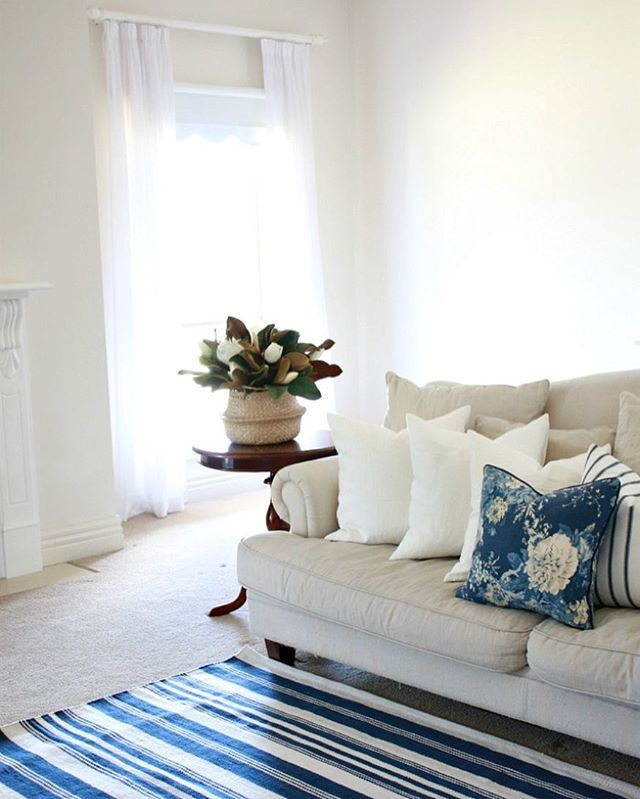 Blue and white living room with a blue and white striped rug. Pottery Barn Rug.
