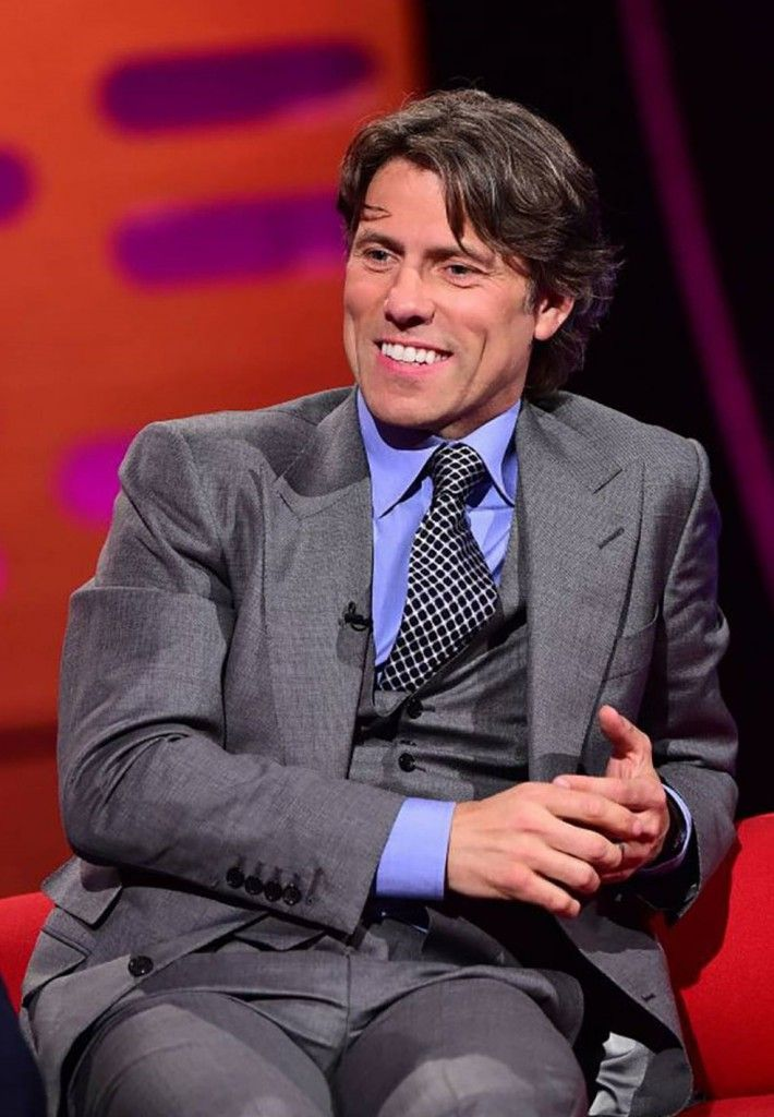 John Bishop  - sharp and sleek in suiting that gleams