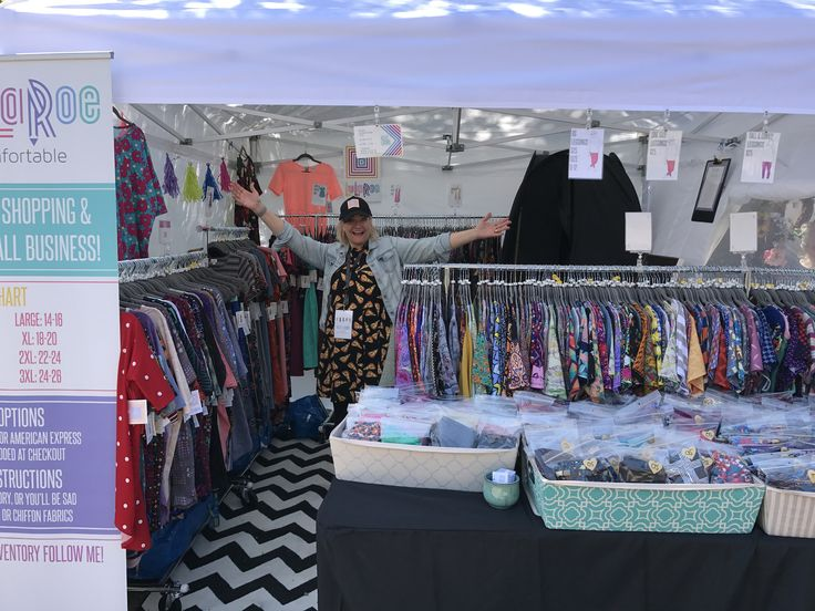 LuLaRoe booth at our local fair.  10x10 tent is from Sam's. We were able to fit a changing room & mirror inside as well!
