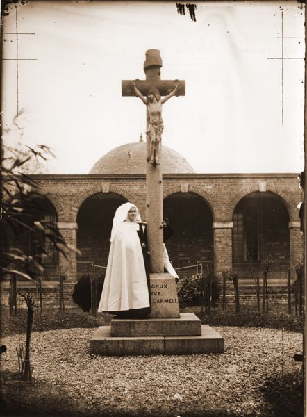 A very seldom-seen photo of St. Therese of Lisieux as a novice, standing in the courtyard at Le Carmel monastery.  Taken in 1889.