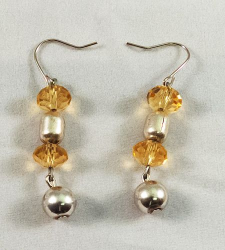 These are gorgeous earrings made with yellow and metallic beads. They measure at 3 cm.
