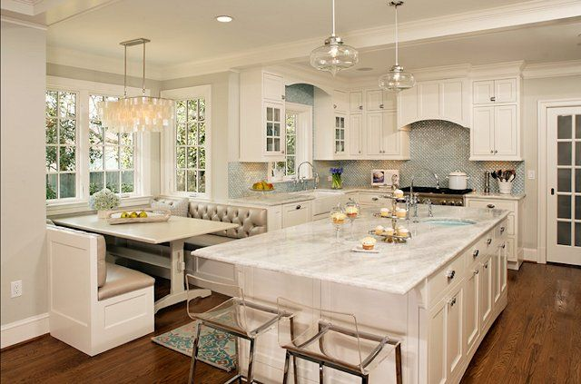 White Kitchen with built-in breakfast booth - A booth is often a great idea in addition to the Casual Dining / Breakfast Room...