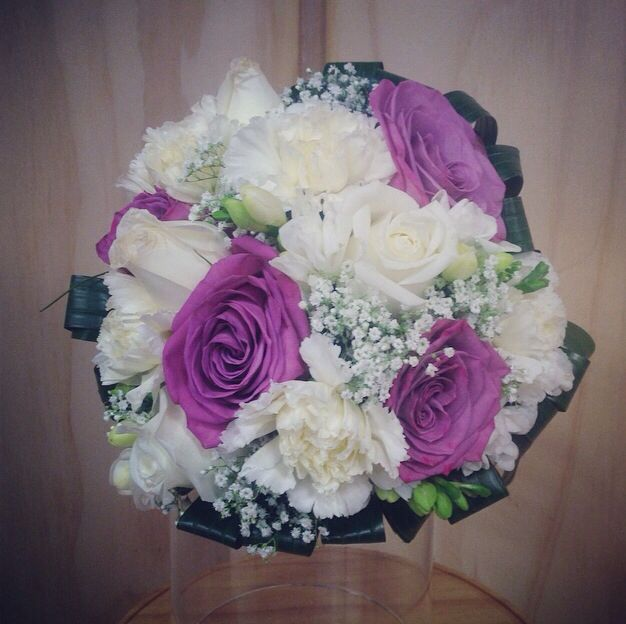 Little flower lane. Roses, freesia and carnations. Wedding bouquet maids.