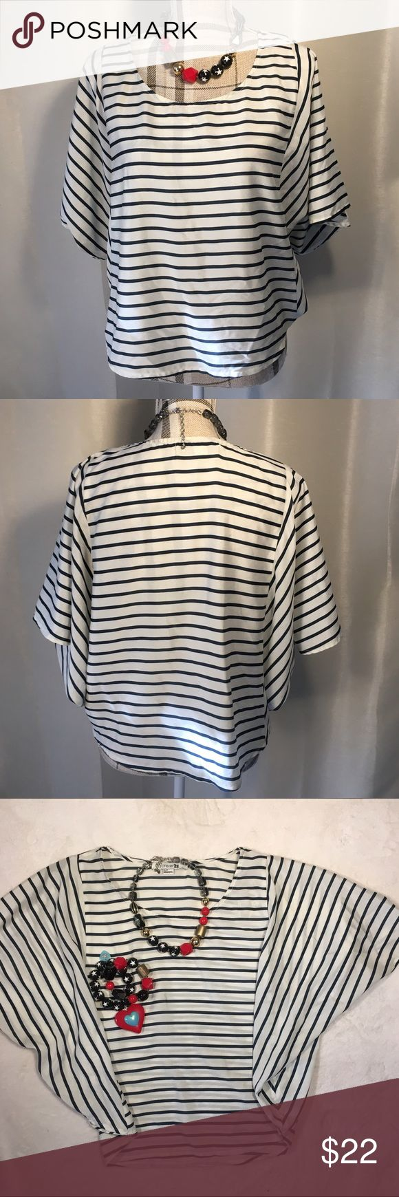 """Navy and white stripe top White and navy striped blouse. Fits """"pancho style"""". Is very flattering on. Only worn once Forever 21 Tops Blouses"""