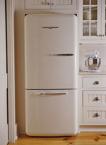 1950's Fridge in a modern white kitchen with warm honey wood plank flooring and farm-style but streamlined look.