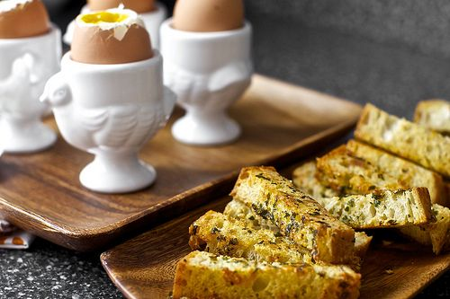 Soft eggs with buttery herb-gruyere toast