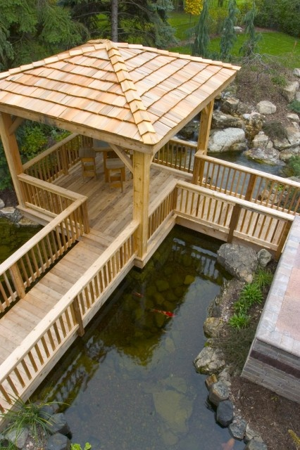 CONNECTING PATHS TO THE DECK OVER A POND.