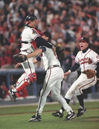 This was a great moment!!  :)   Chipper Jones joins Mark Wohlers and Javy Lopez in front of the mound after the last out of the 1995 World Series.