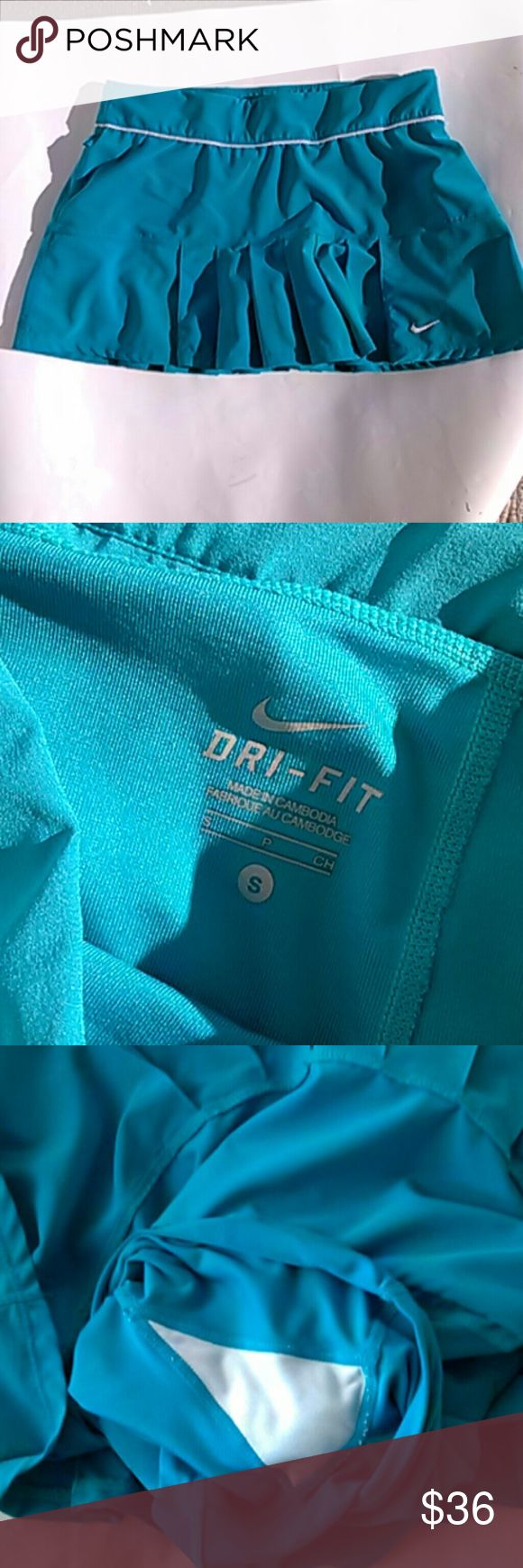 "Nike Pleated Sports Skirt Beautiful turquois measurements waist 30"" HIPS 19"" 12"" inches long in front and back DRI-FIT Built in shorts Gently pre-loved Size Small Nike Shorts Skorts"