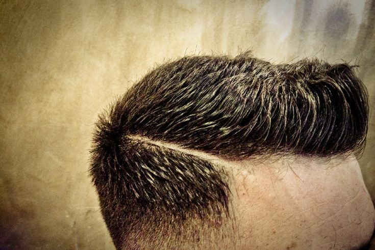Here's a mens 'Faux Hawk' cut, a Faux Hawk is basically a remodelled Mohawk. For this style to be effective there needs to be contrast between length of the hair on the sides and on top. The hair is therefore initially clippered close on the back & sides and tapered off, the hair on top is then taken to the desired length keeping it short at the back to create the hawk shape. The cut is then polished off with a razor parting - Very fresh!