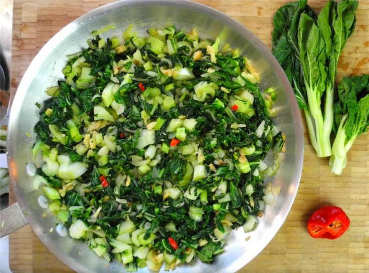 Baby Pak Choi With Salted Cod The Caribbean Way. ---  2 lb baby pak choi 1 cup prepared salted cod 1/2 teaspoon black pepper 1/4 scotch bonnet pepper 1 large onion (diced) 4 cloves garlic (diced) 2 tablespoon olive oil