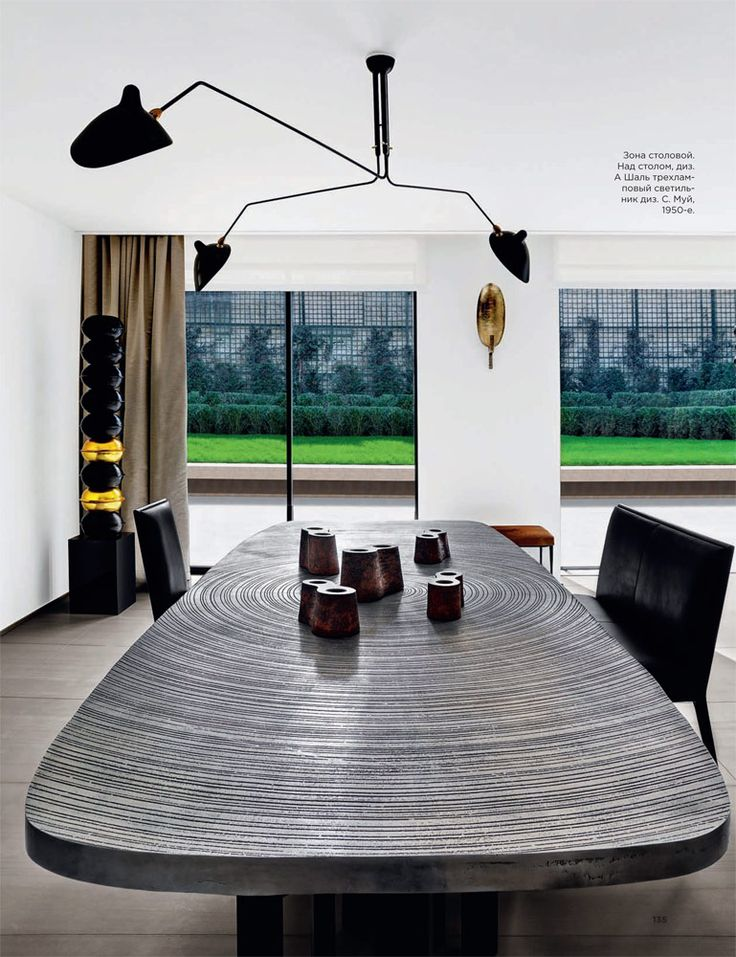 """Apartment in Neuilly-Sur-Seine France by Olivier Dwek - cast aluminum table """"Goutte d'Eau"""" by Belgian designer Ado Chale"""